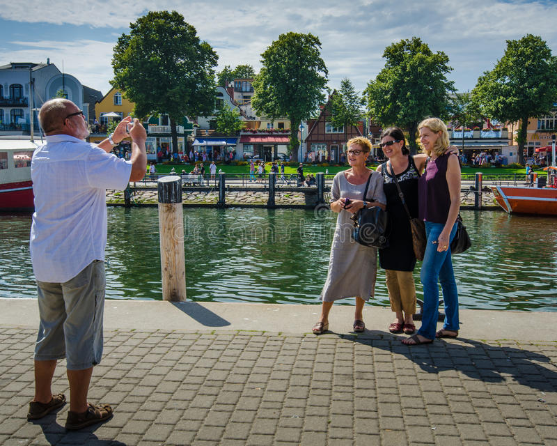 tourists pose for photos in historic seaside resort of