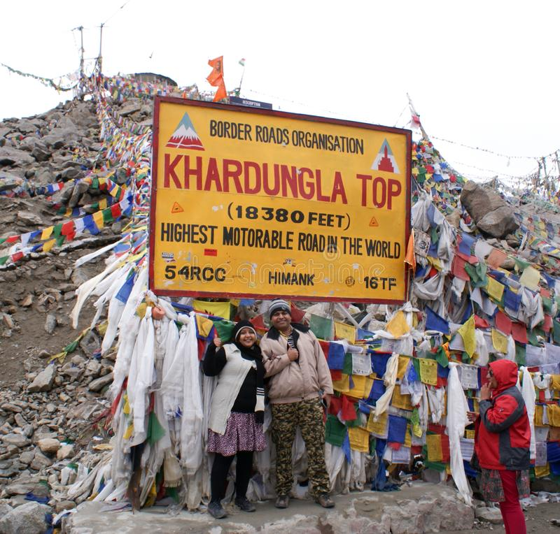 Tourists posing at Khardungla Top, world`s highest motorable road. Located at 18,380 feet above mean sea level, en-route from Leh to Nubra Valley royalty free stock images