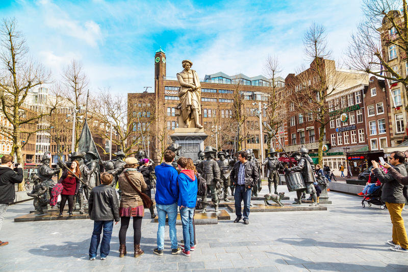 Tourists posing near Night Watch by Rembrandt in Rembrandtplein, Amsterdam stock photos