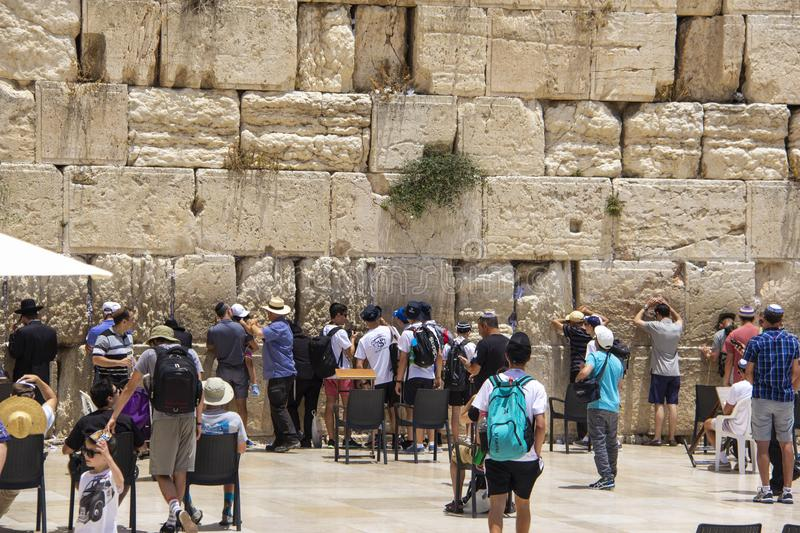 Tourists Praying at the Western Wall royalty free stock image