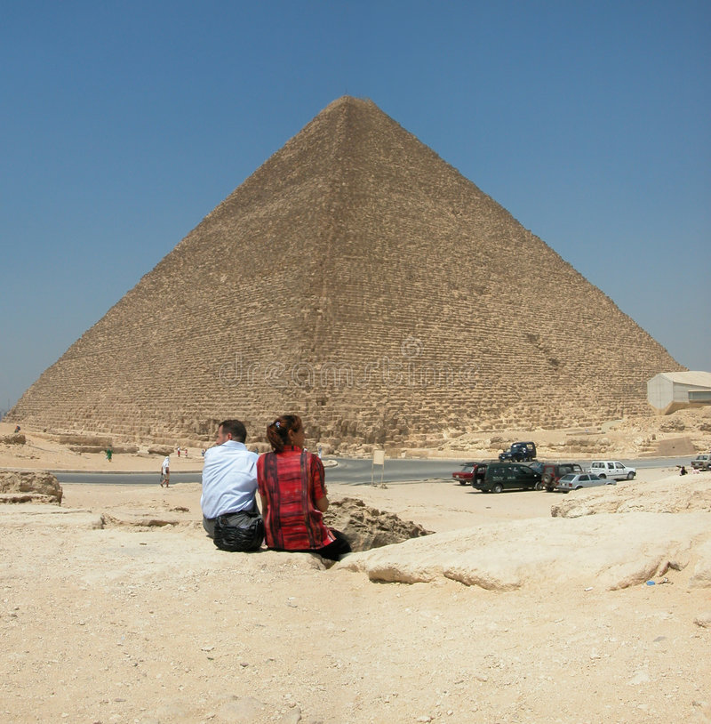Tourists at the Pyramid of Khufu. Giza in Egypt. Tourists at the Pyramid of Khufu at Giza in Egypt royalty free stock image