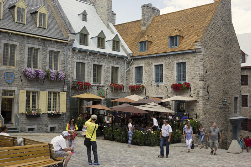 Tourists in Quebec City in Canada. People taking pictures, walking, sitting, relaxing in a nearby restaurant in Quebec City in Canada. Photo taken on: July 12th stock images