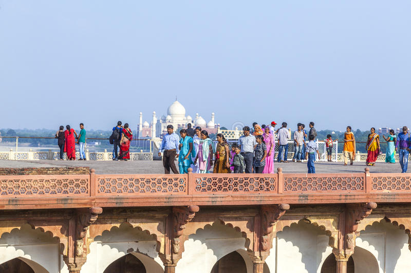 Download Tourists In The Red Fort In Agra With The Taj Mahal In The Background Editorial Photo - Image of hinduism, architecture: 39510441