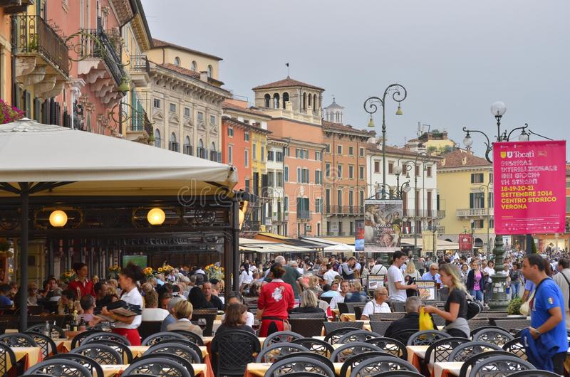 Tourists in restaurants and traditional architecture of Verona Italy royalty free stock photos
