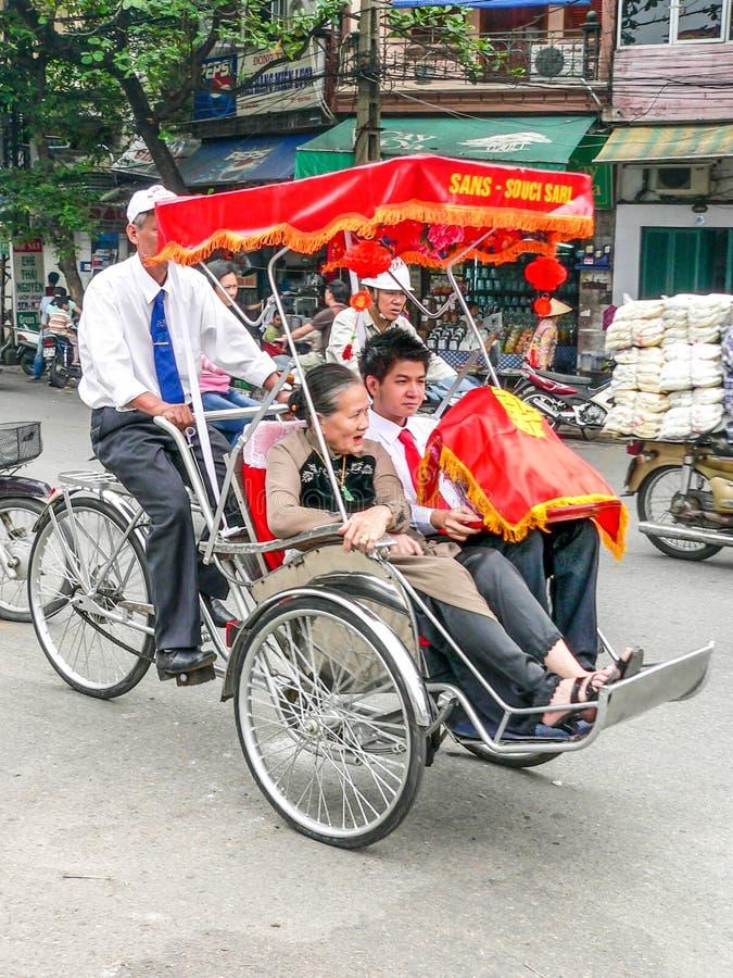 Tourists in rickshaws stock photo