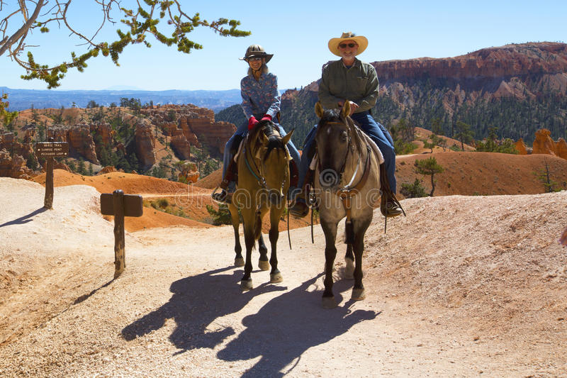 Tourists ride horses on horse trial at Bryce Canyon National Park in Utah. BRYCE CANYON, UTAH - SEPTEMBER 23: Tourists ride horses on horse trial at Bryce Canyon stock photo