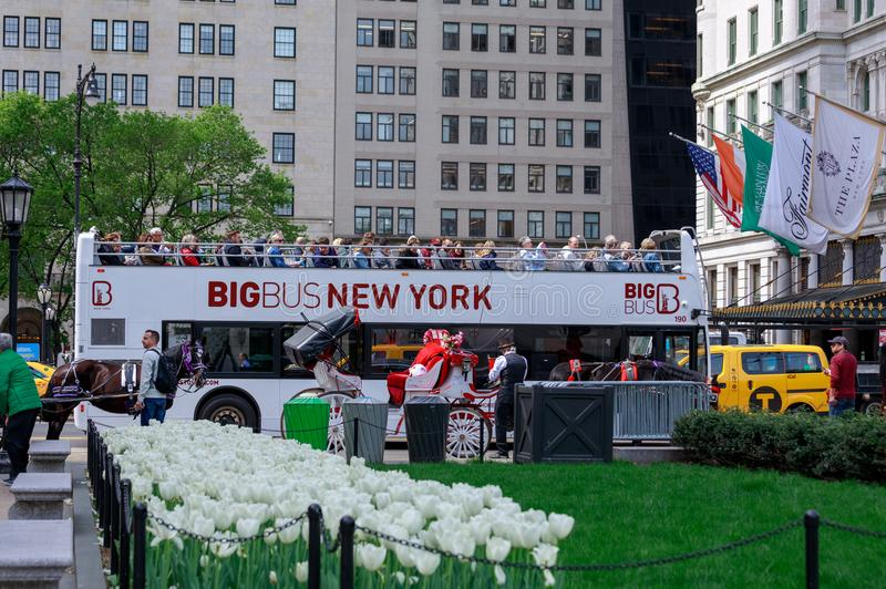 Tourists riding on Big Bus New York in Midtown Manhattan, NYC. New York, USA - May 6, 2018 : Tourists riding on Big Bus New York in Midtown Manhattan, NYC stock images