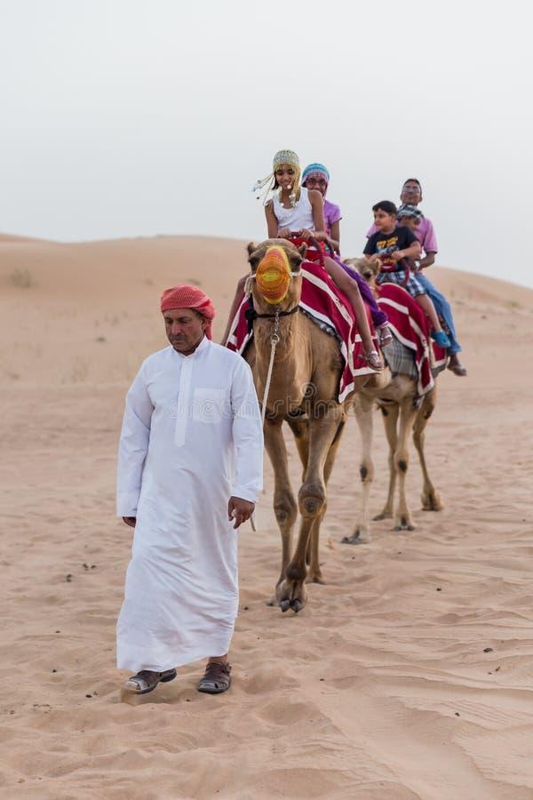 Camel Rides In Dubai Tourists Riding Camel ...