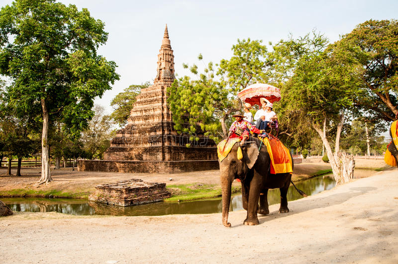 Tourists riding on the elephant at ancient temple in Ayutthaya city. AYUTTHAYA ,THAILAND-APRIL 14,2016 :Unidentified Tourists riding on elephants along the way royalty free stock photography