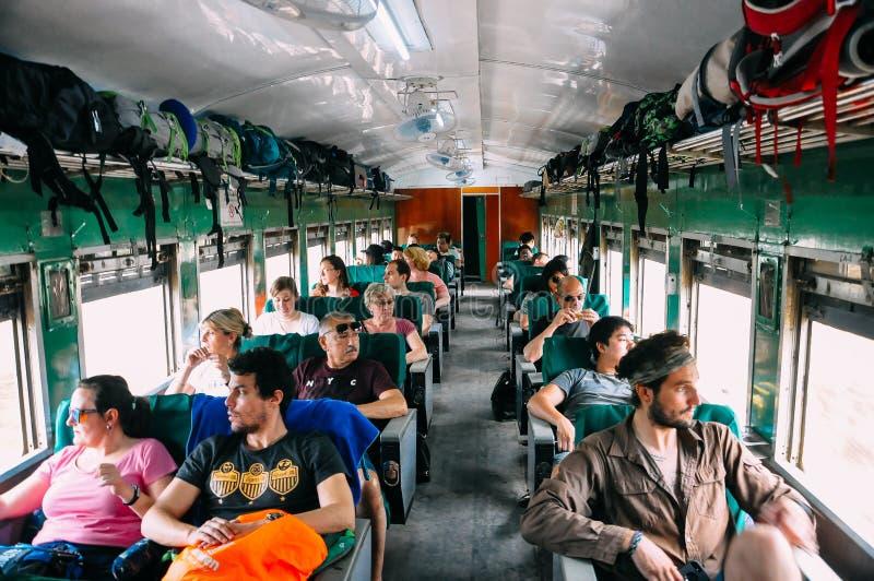 Tourists riding a train to Mandalay. Tourists riding a train to Mandalay, Myanmar royalty free stock photos