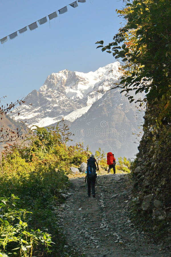 Tourists on road in Nepal stock photos