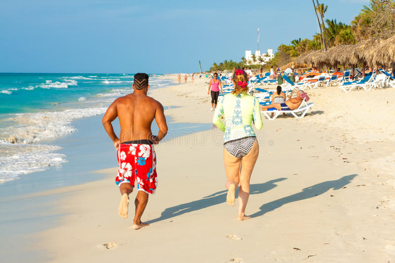 Download Tourists Running At The Beach Of Varadero In Cuba Editorial Photography