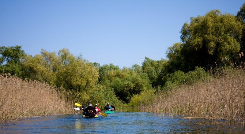 Tourists sailing on kayak stock image