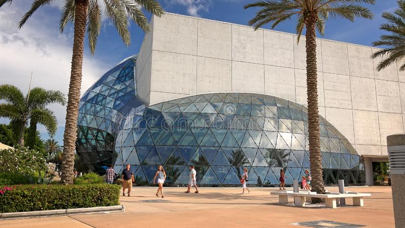 Tourists at the Salvador Dali Museum in St Petersburg, Florida. ST PETERSBURG, FLORIDA - MAY 29th: Unidentified visitors walk in front of the Salvador Dali royalty free stock photography