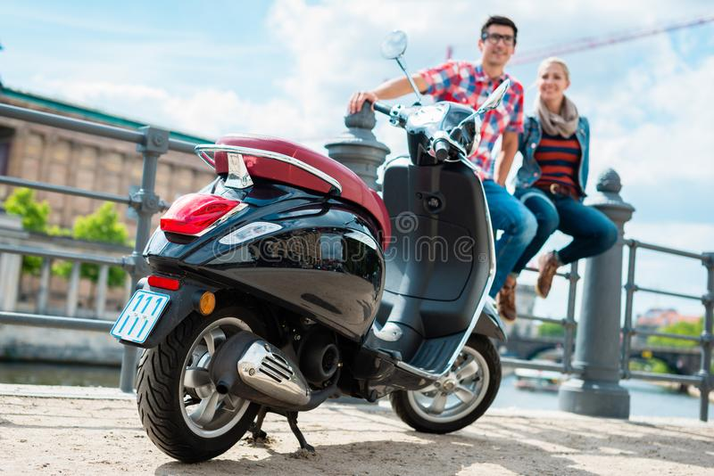 Tourists on a scooter trip taking rest on the Musuem Island royalty free stock photo