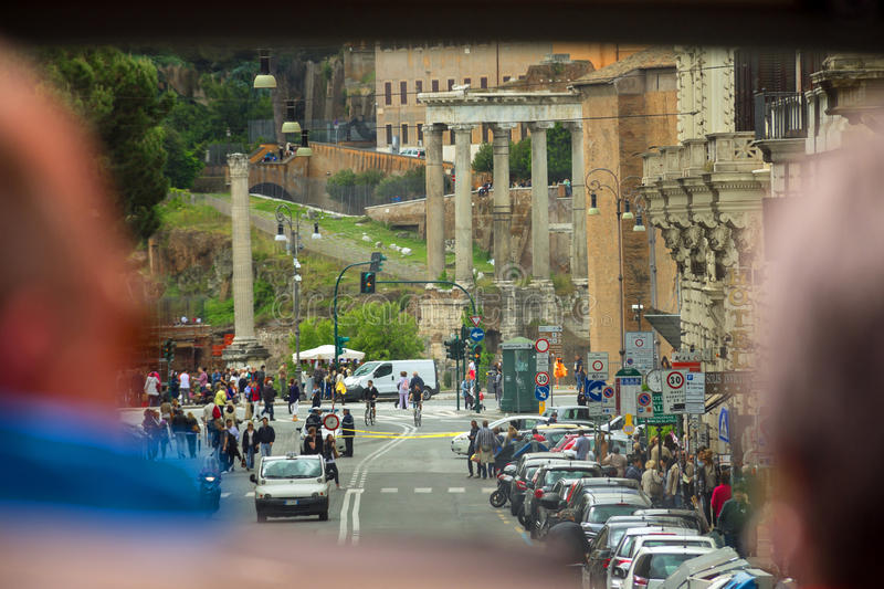 Tourists see the sights of Rome from the window of a tourist b. ROME, ITALY - MAY 03, 2014: Tourists see the sights of Rome from the window of a tourist bus royalty free stock photos