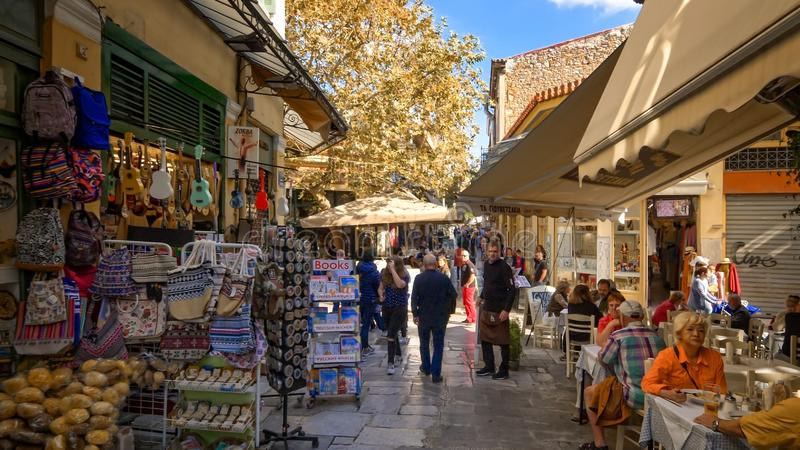 Shopping and Outdoor Cafes in Plaka Neighborhood, Athens, Greece. Tourists shopping and enjoying outdoor cafe in the famous Plaka neighborhood in Athens, Greece stock photos