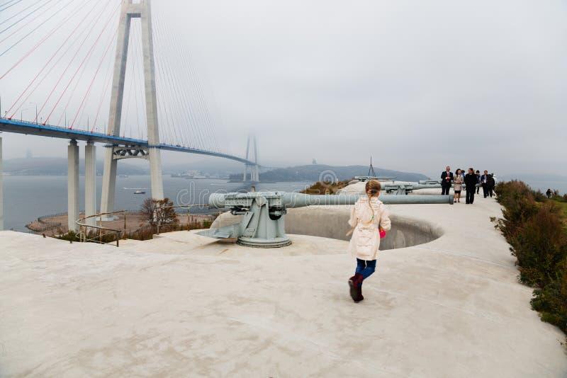 Tourists on the shore batteries of Vladivostok fortress. VLADIVOSTOK, RUSSIA - OCTOBER 18, 2015: Tourists on the old coastal battery Vladivostok fortress on the royalty free stock image