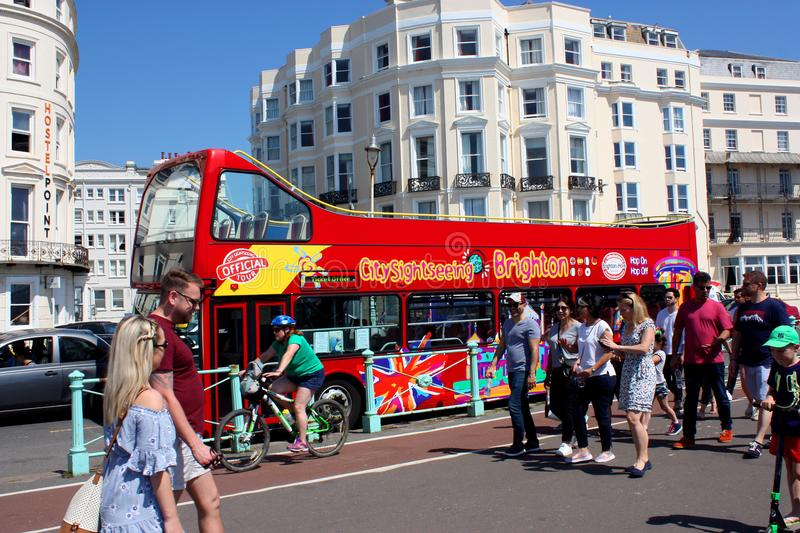 Tourists and sight seeing bus, Brighton, Sussex, England stock image