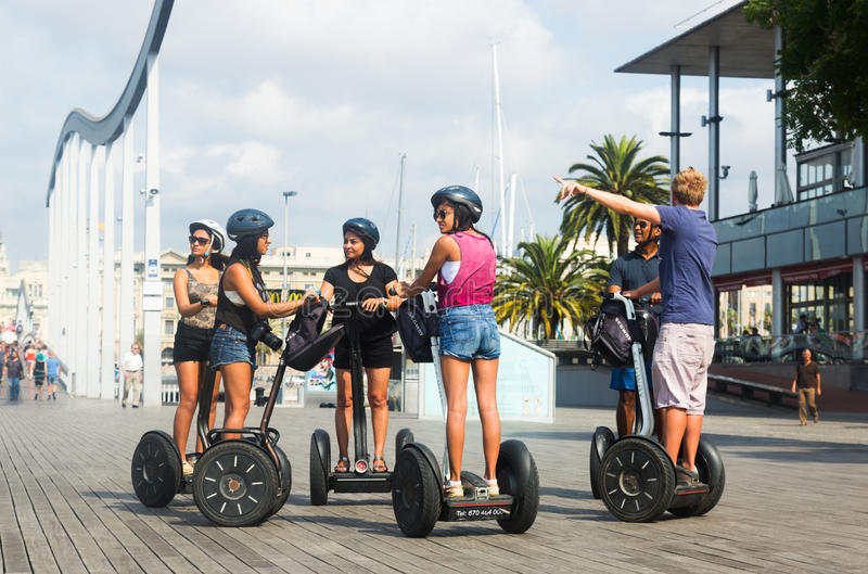 Tourists sightseeing on Segway tour of Barcelona. BARCELONA, SPAIN - JULY 6, 2014: Tourists sightseeing on Segway tour of Barcelona stock images