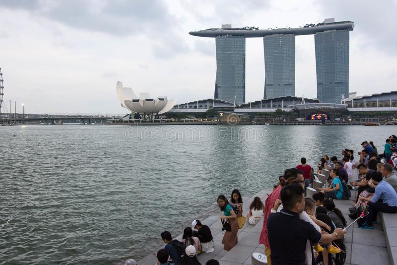 Tourists at the Singapore Merlion Park overlooking Marina Bay Sa royalty free stock images