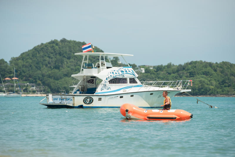 Tourists sit on a rubber boat at samui islands stock image