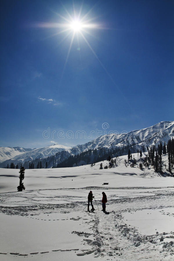 Tourists at snow covered landscape, Kashmir, Jammu And Kashmir, India. Tourists skiing on the snow covered landscape, Kashmir, Jammu And Kashmir, India royalty free stock images
