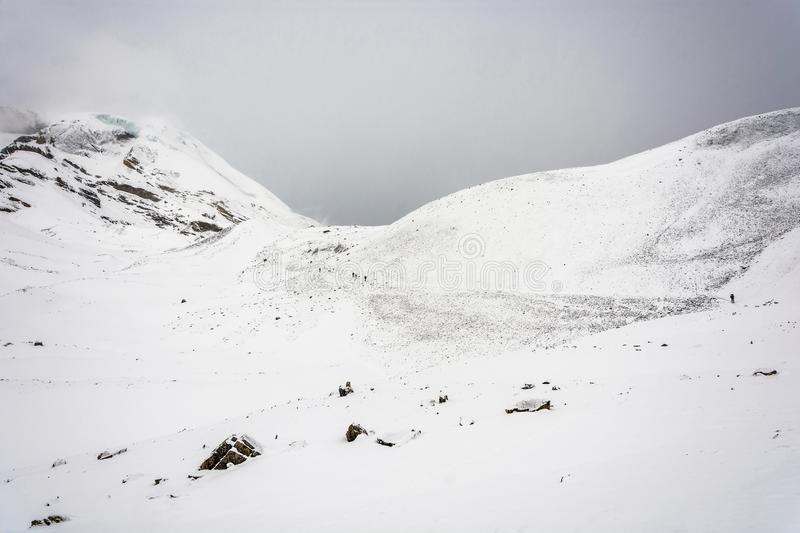 Tourists on a snow-covered Thorung La pass, Nepal. stock photography