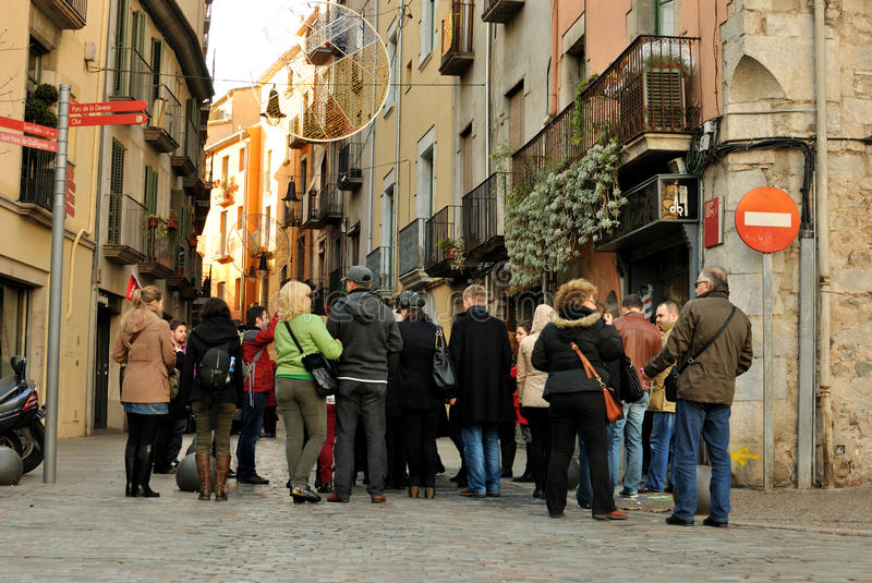 Tourists in Spain. Group of tourists with guide in Jewish Quarter in Girona, Catalonia, Spain. Spanish Jews once constituted one of the largest and most stock images