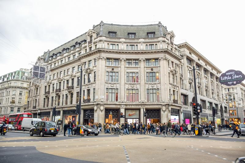 Tourists spending their time at Oxford Street, the most europe`s busiest shopping street in London, UK. Tourists spending their time at Oxford Street, the most royalty free stock photos