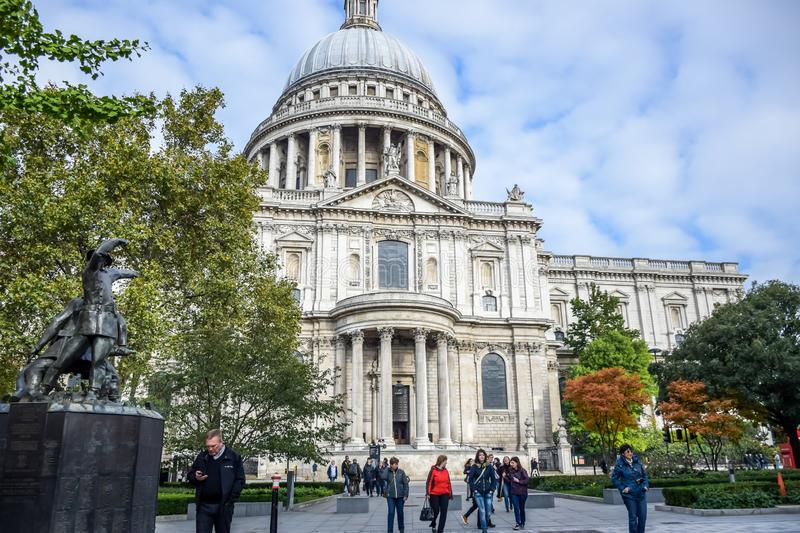 Tourists spending their time at St Paul`s Cathedral facade in London, England, United Kingdom royalty free stock images