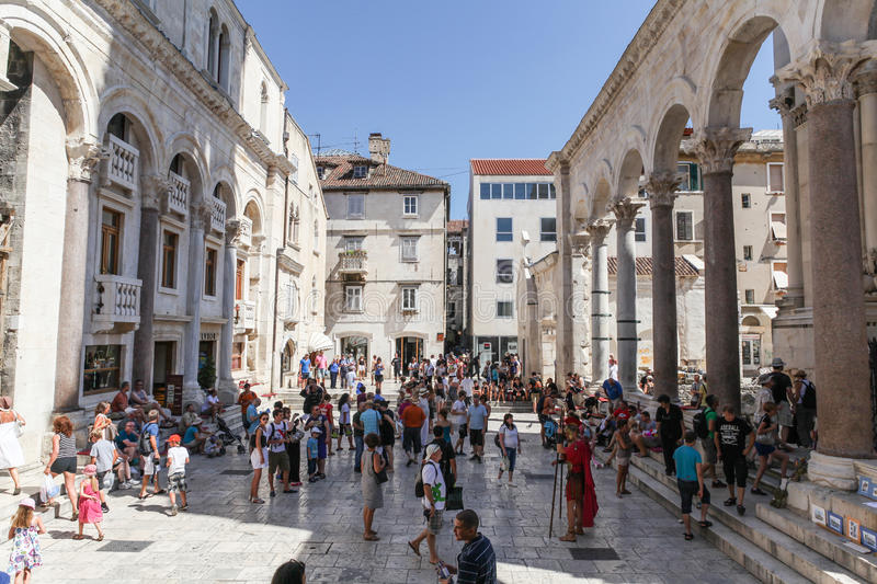 Tourists in Split, Croatia. Split, Croatia - August 5, 2012: Tourists at the entrance of the Palace of Diocletian in the Historical Complex of Split, Croatia