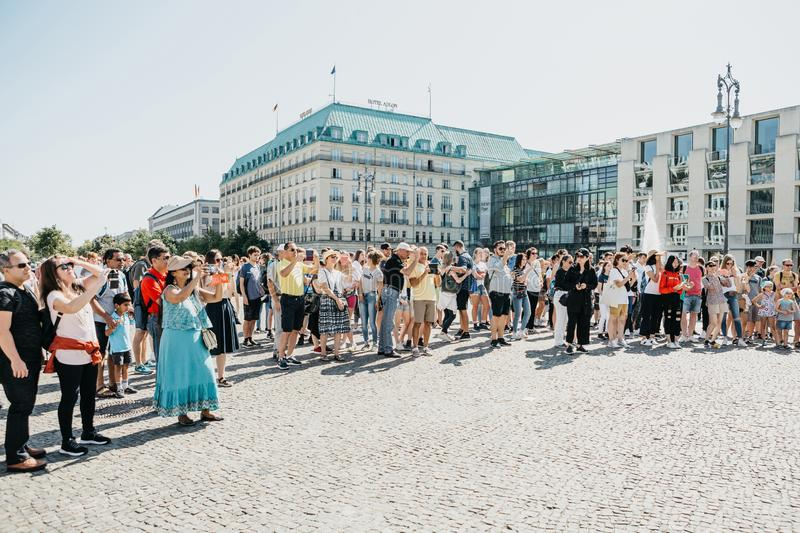Tourists on the square next to the Brandenburg Gate look at the sights and take pictures. Germany, Berlin, September 05, 2018: Tourists on the square next to the royalty free stock images