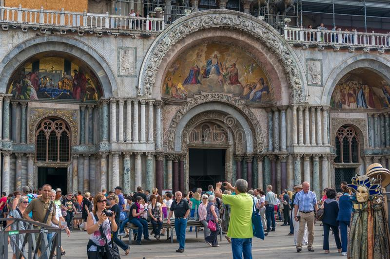 Tourists on St Mark Square in front of St Mark Cathedral taking photos and enjoying themselves royalty free stock photos