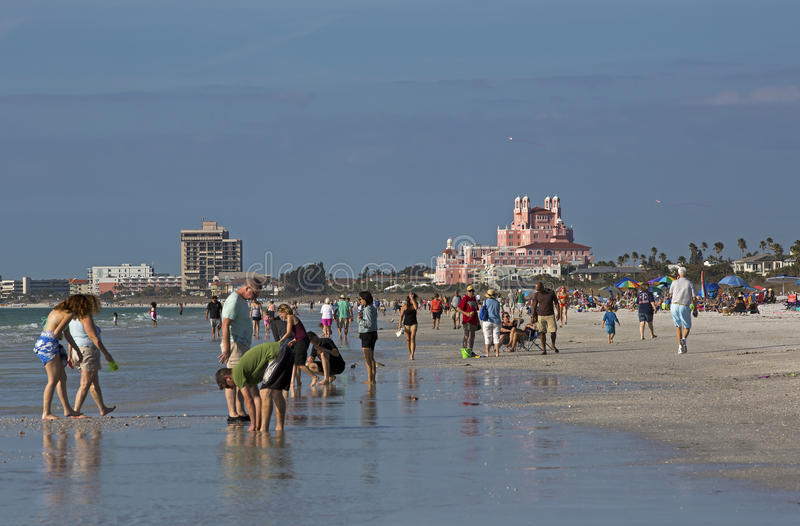 Tourists on St. Pete Beach, Florida. Travelers enjoy the warm morning sun on St. Pete Beach, Florida royalty free stock images