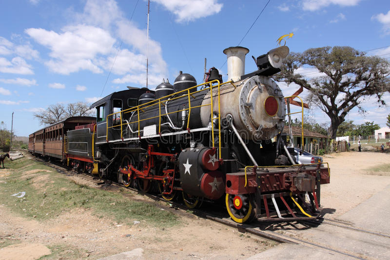 Tourists steam old train, cuba, trinidad royalty free stock image