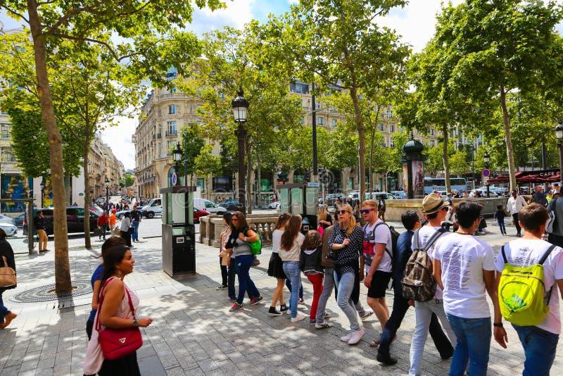 Tourists stroll at Champs-elysees - Paris. PARIS, Aug. 22 2014 : Local and tourisrs stroll at des Champs-elysees Avenue des Champs Elysees is the biggest and stock photography