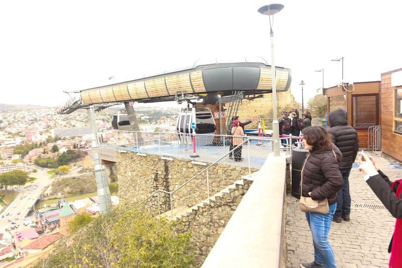 Tourists stroll in Tbilisi street- Georgia. Tourists stroll in Tbilisi, Georgia - March , 2018: Old Tbilisi and Downtown stock photos