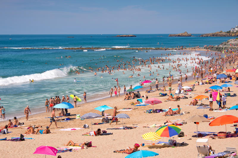 Tourists in summer on Milady beach, in Biarritz royalty free stock image
