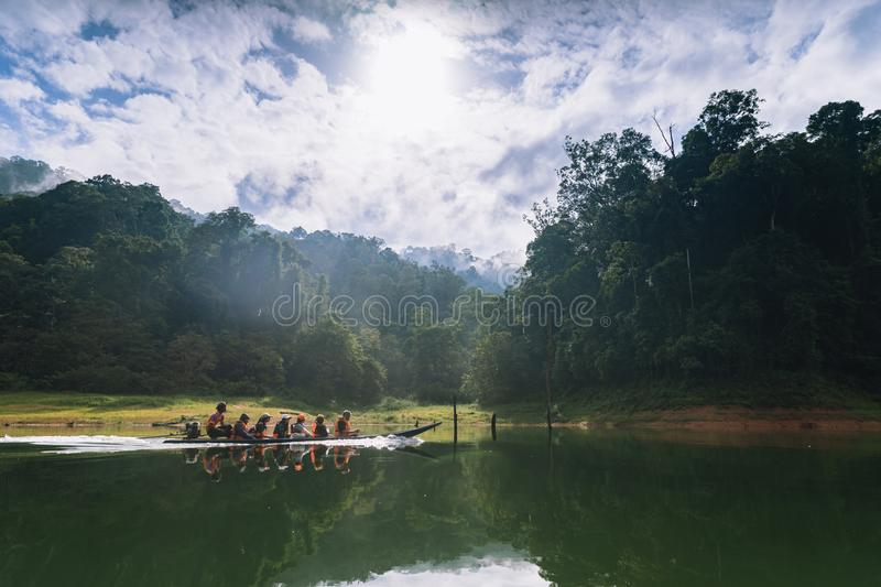 Tourists take a boat to see the scenery of the forest, wildlife and Bang Lang reservoir. royalty free stock images