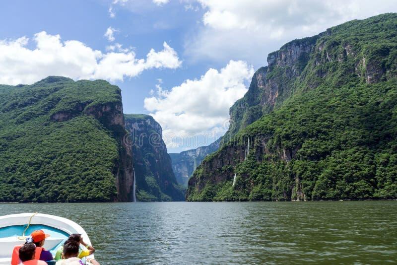 Tourists take Boat Tour through Sumidero Canyon, Chiapas, Mexico. Tourists take Boat Tour through Sumidero Canyon on the Grijalva River in Chiapas / Mexico stock photos