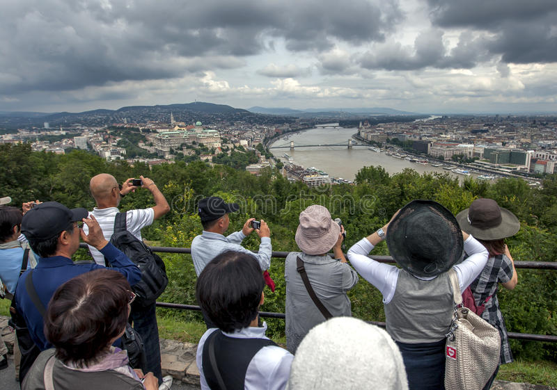 Tourists take photographs of the Danube River in Budapest in Hungary. royalty free stock image