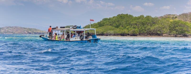 Tourists taking a boatride at Menjangan Island. Near Bali, Indonesia royalty free stock images