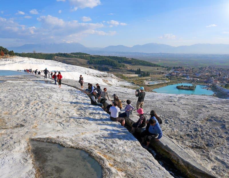 Tourists taking foot bath in Pamukkale, Turkey stock photos