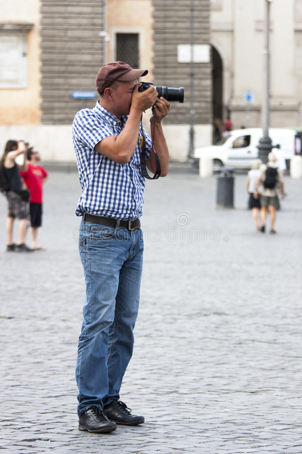 Tourists taking a photo with digital camera royalty free stock images