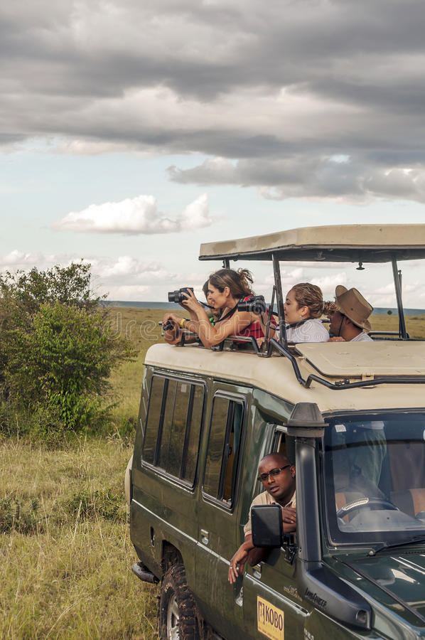 Tourists taking photos. In a car on a safari in Kenya, picture taken in May 2014, it´s a vertical picture stock photos