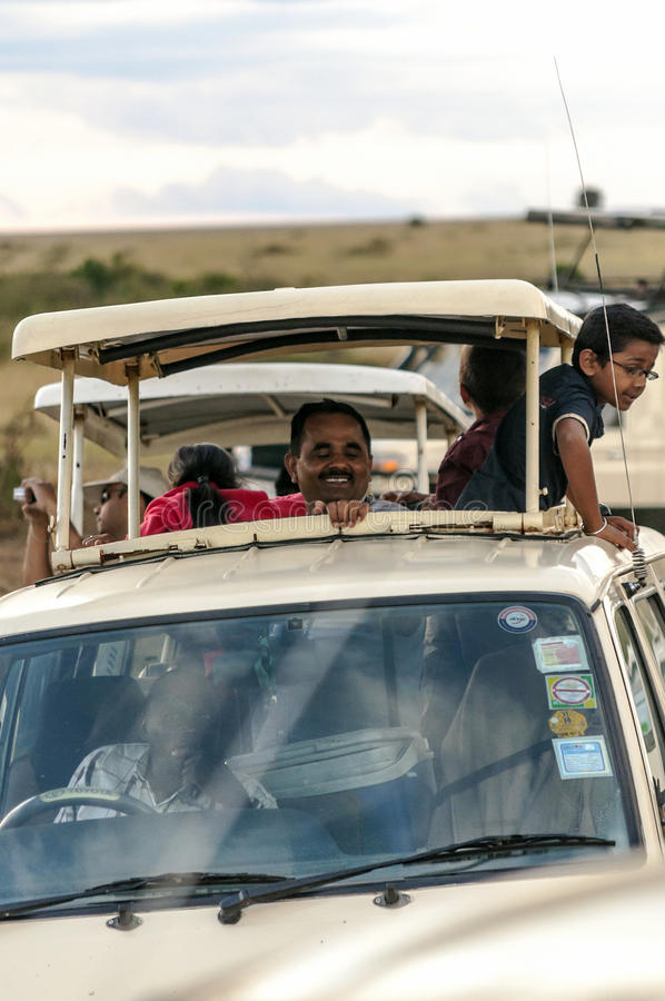 Tourists taking photos. In a car on a safari in Kenya, picture taken in May 2014, it´s a vertical picture royalty free stock image