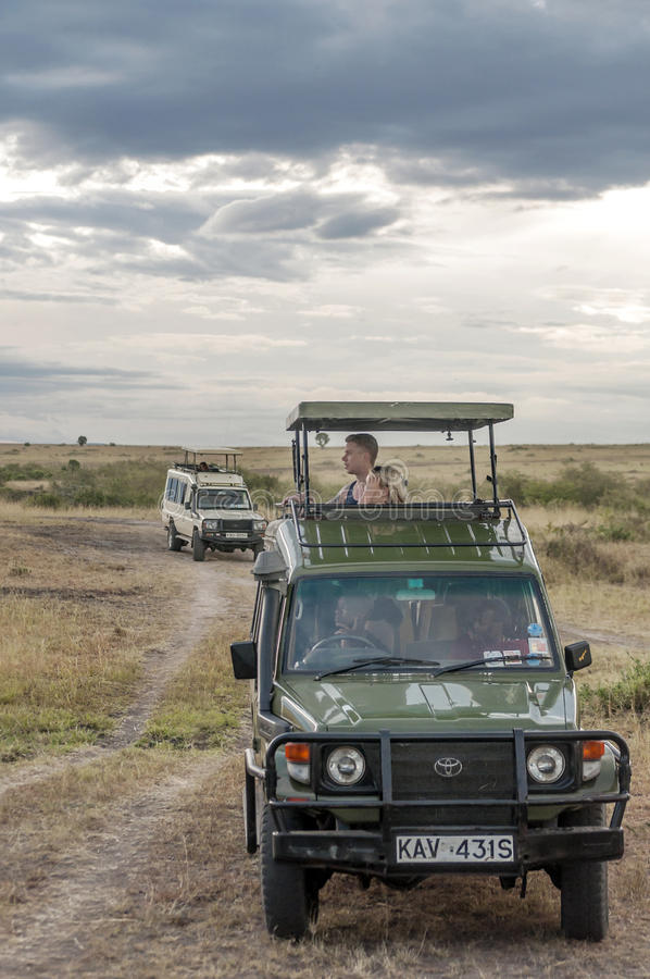 Tourists taking photos. In a car on a safari in Kenya, picture taken in May 2014, it´s a vertical picture stock photo