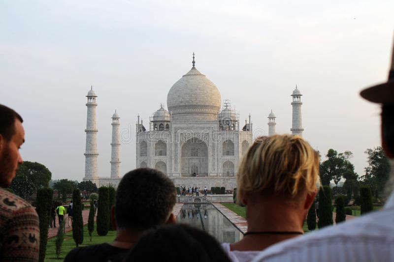 The tourists taking photos of Taj Mahal in a crowd royalty free stock images