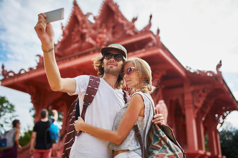 Tourists taking photos at temple on koh samui thailand stock photos